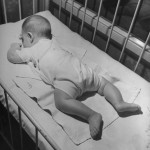 nina-leen-baby-sleeping-on-its-stomach-in-nursery-at-st-vincent-s-hospital